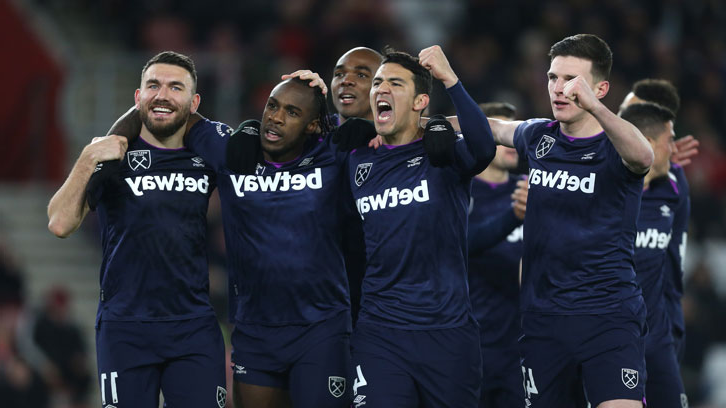 Fabian Balbuena and his teammates celebrate at St Mary's Stadium