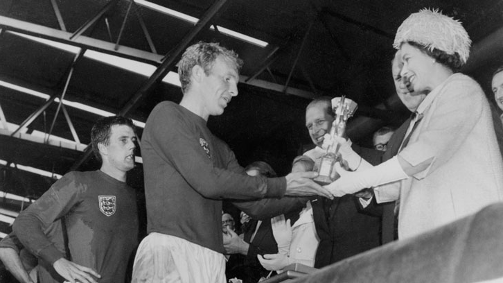 Bobby Moore is presented with the Jules Rimet Trophy