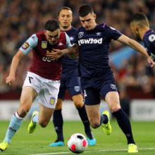 Declan Rice holds of Aston Villa's John McGinn