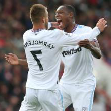 Issa Diop celebrates with Andriy Yarmolenko at Vitality Stadium