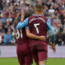 Andriy Yarmolenko celebrates with Mark Noble