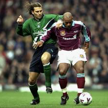 Trevor Sinclair takes the ball away from Patrik Berger