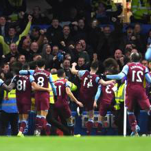 West Ham players celebrate at Chelsea