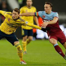 Mark Noble grapples with Mesut Ozil