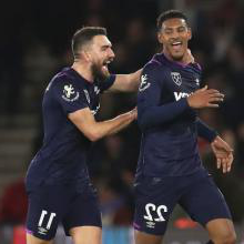 Sebastien Haller celebrates with Robert Snodgrass