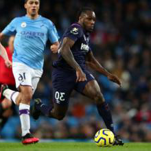 Michail Antonio runs at the Manchester City defence