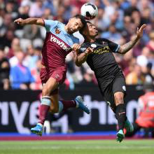 Ryan Fredericks in action against Manchester City