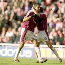 Frederic Kanoute celebrates scoring against Sunderland