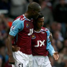 Carlton Cole and Nobby Solano celebrate