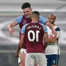 Declan Rice celebrates with Manu Lanzini