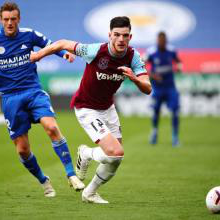 Declan Rice takes the ball away from Jamie Vardy