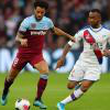 Felipe Anderson runs away from Jordan Ayew