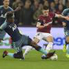 Declan Rice is challenged by Victor Wanyama
