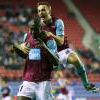 Mark Noble and Carlton Cole celebrate at Wigan