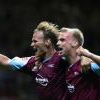 Teddy Sheringham celebrates with Luke Chadwick